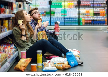 Couple eating junk food Stock photo © photography33