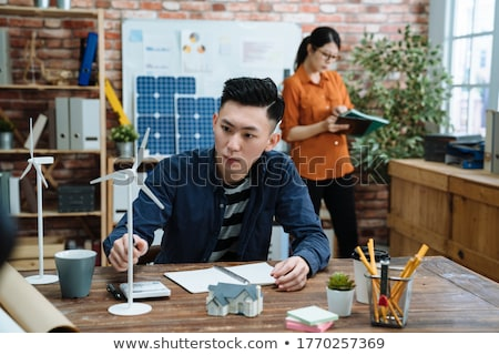 solar panels windmills and employees stock photo © photography33