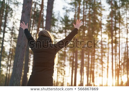 Armed woman in the winter forest Stock photo © acidgrey