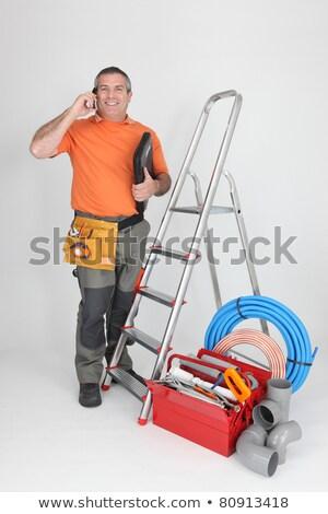 Uomo telefono cellulare scala plumbing strumenti costruzione Foto d'archivio © photography33