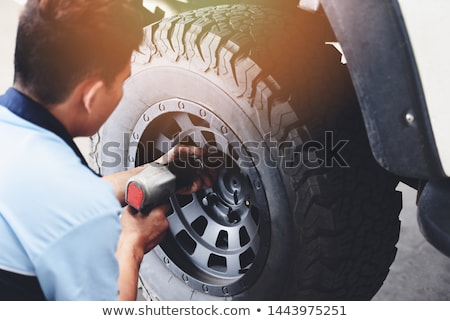 mechanic changing a tire Stock photo © photography33