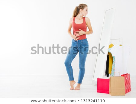 young woman fits on a dress stock photo © ssuaphoto