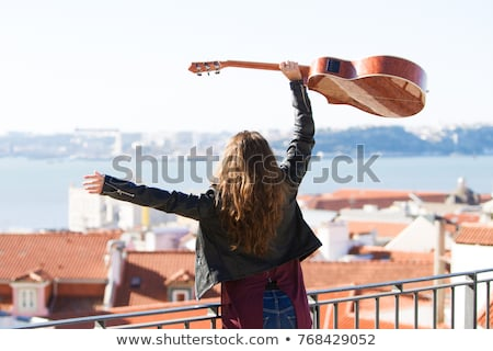 Young brown-haired woman holding guitar Stock photo © photography33