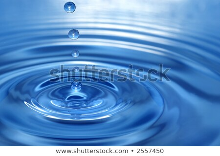 The round transparent blue drop of water, falls downwards... Stock photo © Zhukow