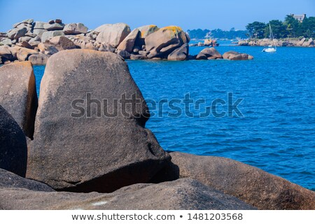 huge granite boulder on blue sky background  Stock photo © Bertl123