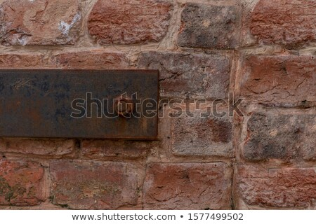 Old rusty clamp in a brick wall Stock photo © michaklootwijk