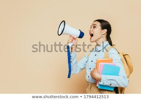 Attractive brunette with a loudspeaker Stock photo © acidgrey