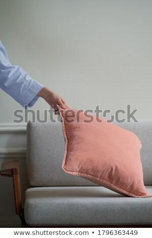 женщину подушкой оружия полу женщины Сток-фото © wavebreak_media