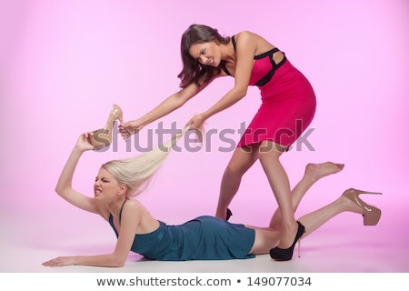 Woman pulling down dress Stock photo © iofoto