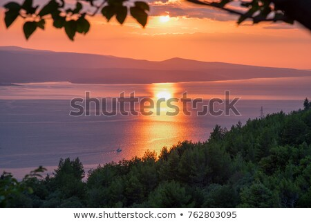 adriatic sunset near baska voda croatia stock photo © anshar