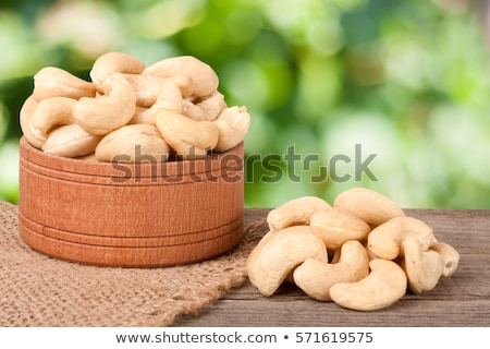 heap of a roasted cashew nuts on an old wooden table stock photo © kirill_m