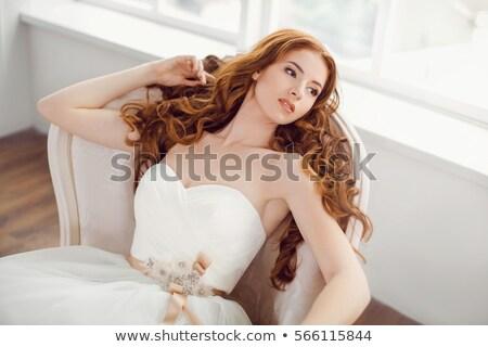Jonge aantrekkelijke vrouw korset rode jurk hand Stockfoto © adam121