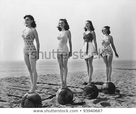retro woman on the beach stock photo © balasoiu
