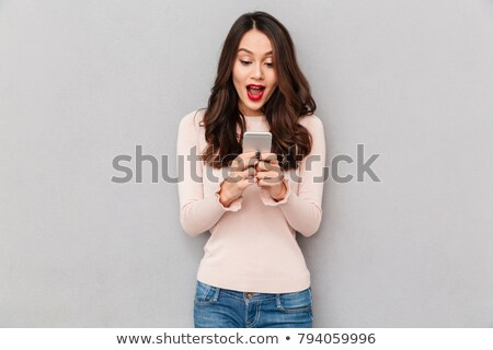 Gorgeous young woman chatting on her mobile Stock photo © dash