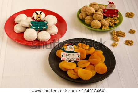 snowman with plate let it snow stock photo © dariazu