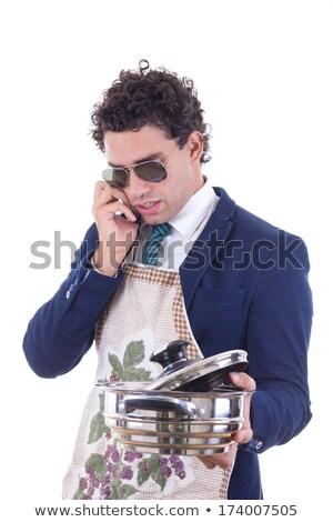 Férfi kötény tart lábas beszél telefon Stock fotó © feelphotoart
