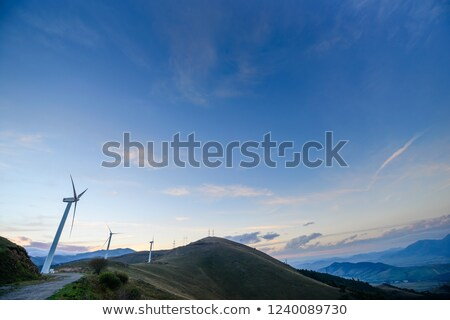 Wind turbine at winding road in a rural landscape Stock photo © olandsfokus