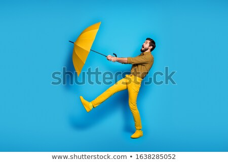 rain man with umbrella stock photo © tracer