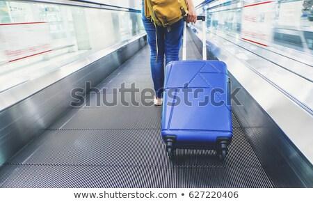 Nők sétál húz bőrönd bemozdult nő Stock fotó © mikdam