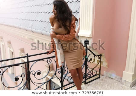 sensual woman in white touching her hair stock photo © dash