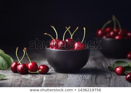 sweet cherry in bowl on rustic table stock photo © stevanovicigor