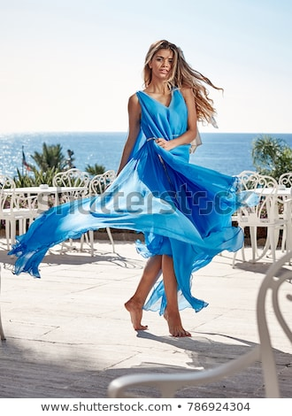 beautiful young red haired woman in blue dress stock photo © aikon