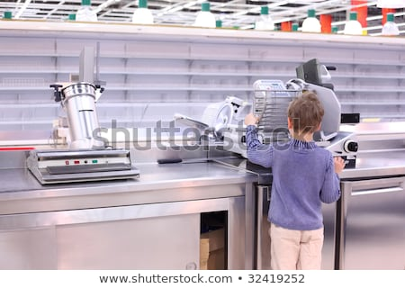 boy stands at scales in empty shop Stock photo © Paha_L