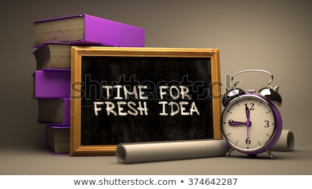 time for fresh idea handwritten by white chalk on a blackboard stock photo © tashatuvango