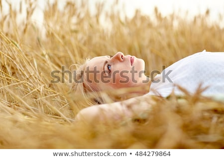 Young pretty woman relaxes on hay Stock photo © Aikon