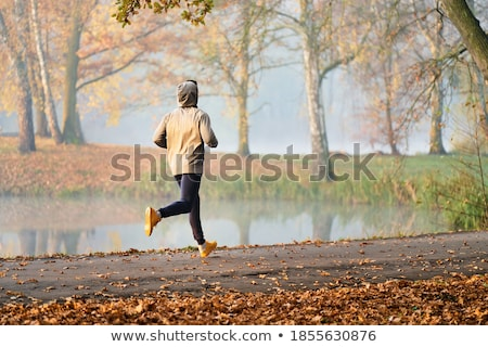 Unrecognizable hooded man jogging outdoors Stock photo © stevanovicigor