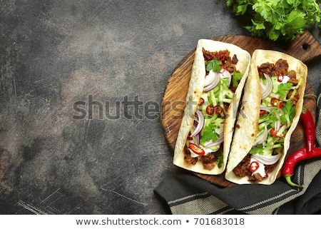 Mexican Tortilla with meat beef and stewed vegetables and spicy sauce. Stock photo © mcherevan
