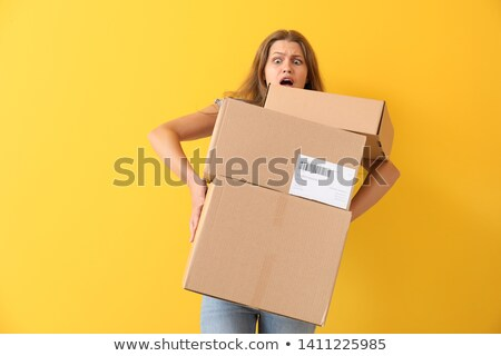 young woman carrying carton boxes stock photo © stokkete