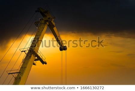 Geel · kraan · bouwplaats · blauwe · hemel · wolken · technologie - stockfoto © blasbike