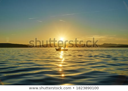 Fishers at beautiful sunset stock photo © joyr