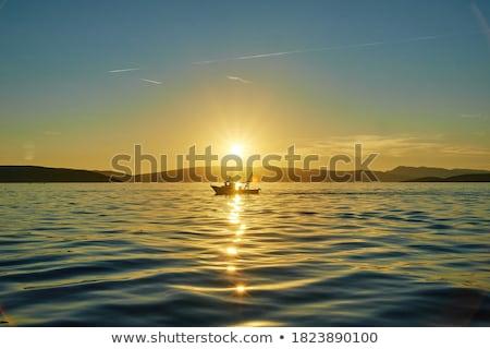 Güzel gün batımı balıkçı balık tutma iskele gökyüzü Stok fotoğraf © joyr
