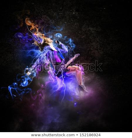 страстный молодые гитарист играет темно студию Сток-фото © feedough