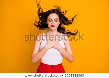 Gyengéd vonzó fiatal nő piros ajkak csukott szemmel lány Stock fotó © deandrobot