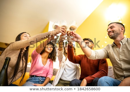 heureux · amis · célébrer · potable · champagne - photo stock © monkey_business