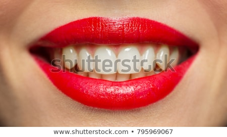 softly smiling female mouth with red lips stock photo © noedelhap