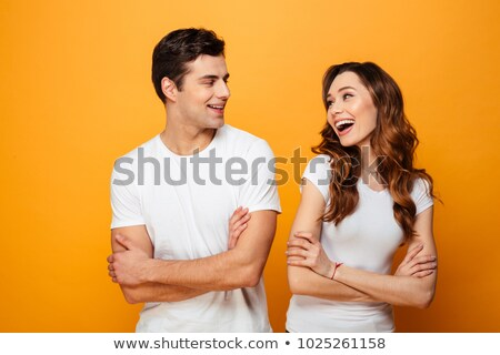 beautiful couple in each others arms stock photo © tekso