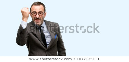 angry frowning middle age man in blue jacket stock photo © julenochek