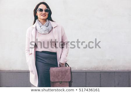 Mujer atractiva caliente abrigo sonriendo mujer Foto stock © wavebreak_media
