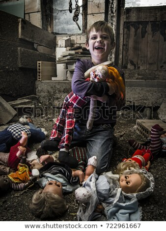 Creepy child and scary dolls in the barn Stock photo © sumners