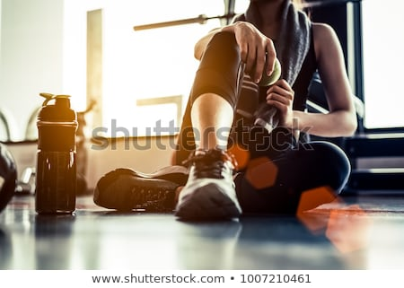 Sportive girl drinking at workout Stock photo © dash