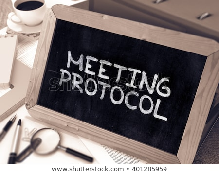 Meeting Protocol Concept Hand Drawn on Chalkboard. Stock photo © tashatuvango