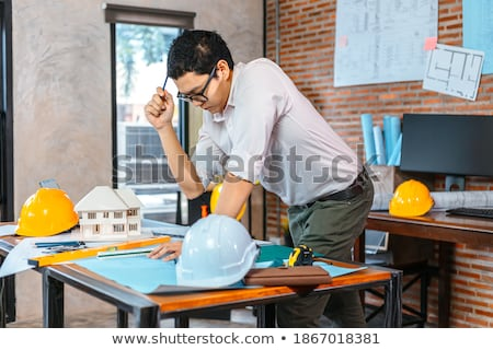 Woman holding blue prints Stock photo © IS2