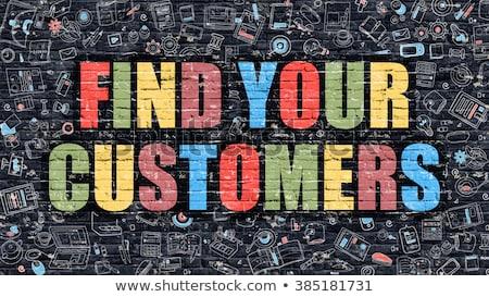 Multicolor Target Your Customers on Dark Brickwall.  Stock photo © tashatuvango