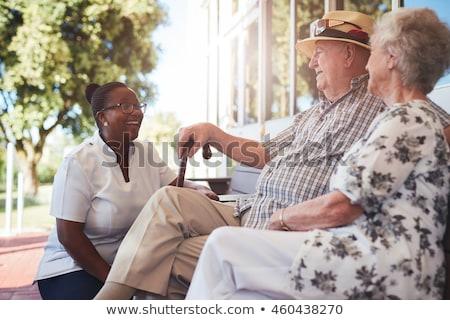 Nővér beszél idős pár nők orvosi pár Stock fotó © monkey_business