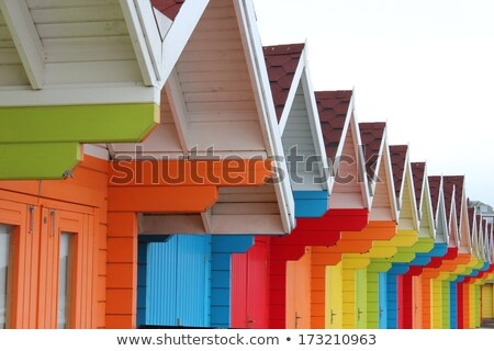 Beach huts with rainbow Stock photo © IS2
