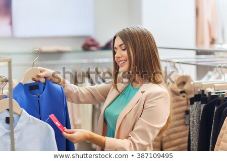 woman looking on sale tag stock photo © LightFieldStudios
